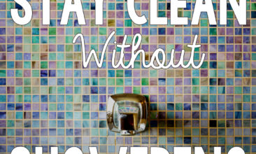 "Image of a colorfully tiled shower with text overlay, ""How to stay clean without showering every day""."
