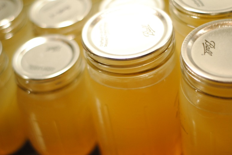 Close up shot of jars of golden bone broth.