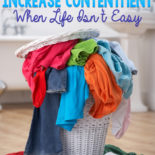 """Image of an overflowing laundry basket with dirty clothes, text overlay says, """"6 small habits to increase contentment when life isn't easy"""""""
