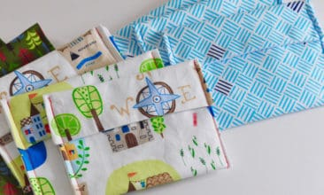 9 DIY snack bags in coordinating prints and colours are laid out on a white surface.
