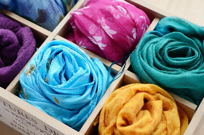 Wooden box with different colorful scarfs