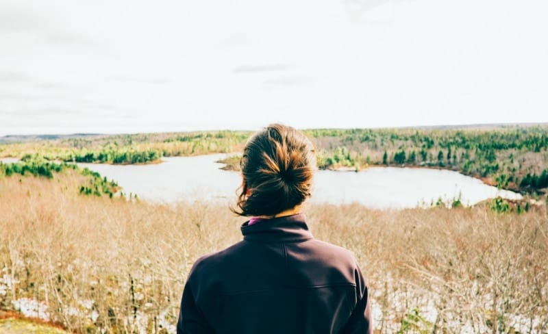 woman looking over lake