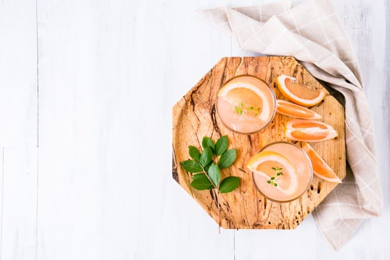 alcoholic beverage cocktails on a wooden tray shot from above as gift ideas for dads